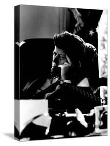 President John F. Kennedy Looking Serious on Telephone in White House during Cuban Missile Crisis by Art Rickerby