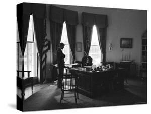 President John F. Kennedy Speaking with Brother, Attorney General Robert F. Kennedy by Art Rickerby