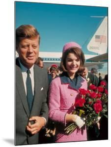 President John F. Kennedy Standing with Wife Jackie After Their Arrival at the Airport by Art Rickerby