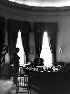 President John F. Kennedy with Brother, Attorney General Robert Kennedy in White House Office by Art Rickerby