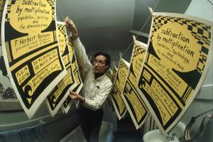 Yale's Zero Population Growth President William Ryserson Hanging Posters to Dry in Bathroom, 1970 by Art Rickerby
