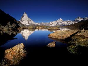 Matterhorn Reflected in Riffelsee, Zermatt, Switzerland by Art Wolfe