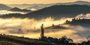 Misty farmland and mountains, Romania by Art Wolfe Wolfe