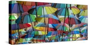 Rainbow umbrellas, Bucharest, Romania by Art Wolfe Wolfe