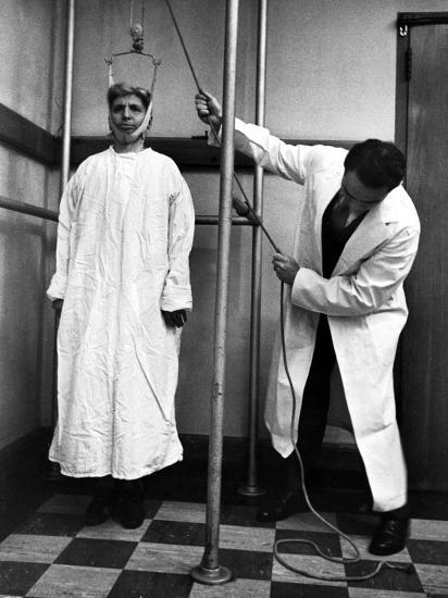 Arthritis Patient Being Treated with Stretching Device at Clinic-Alfred Eisenstaedt-Photographic Print