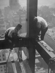 Workmen Attaching Steel Beams High Above Street During Construction of Manhattan Company Building by Arthur Gerlach