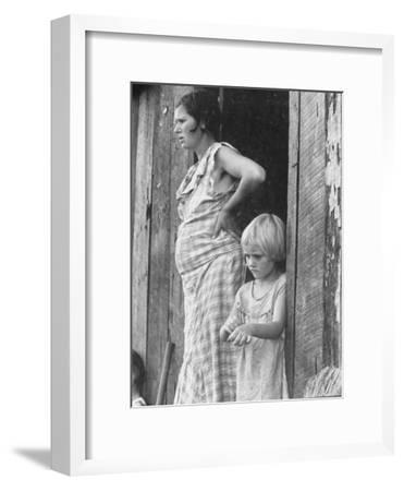 Pregnant Sharecropper's Wife Standing in Doorway of Wooden Shack with Daughter, the Depression