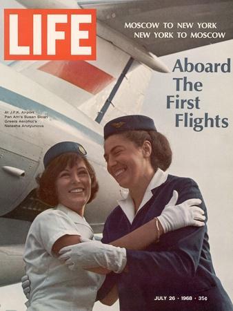 American Pan Am Stewardess Sicari Embracing Russian Aeroflot Stewardess Arutyunova, July 25, 1968