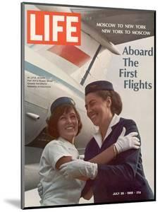 American Pan Am Stewardess Sicari Embracing Russian Aeroflot Stewardess Arutyunova, July 25, 1968 by Arthur Schatz