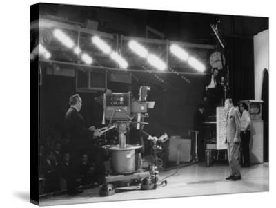 "CBS Cameraman Filming Ed Sullivan During ""The Ed Sullivan Show,"" Cue Cards are Visible Behind Him"