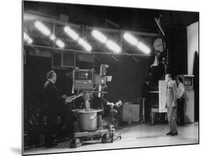 "CBS Cameraman Filming Ed Sullivan During ""The Ed Sullivan Show,"" Cue Cards are Visible Behind Him by Arthur Schatz"