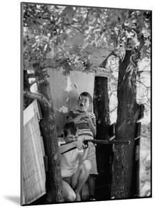 Children Playing in a Treehouse by Arthur Schatz