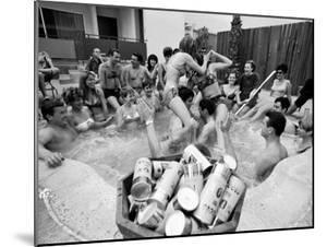 "Pair of Couples ""Chicken Fighting"" in a Crowded Jacuzzi Pool During a Beer Fueled Party by Arthur Schatz"