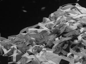 Photo of a Stack of Ticker Tape Covering as the Result of the Selling Climax at the Stock Exchange by Arthur Schatz