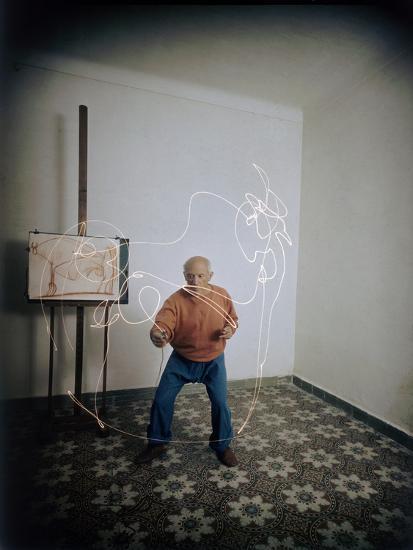 Artist Pablo Picasso Attempting to Draw a Minotaur Using Light Pen, Vallauris, France, 1949-Gjon Mili-Photographic Print