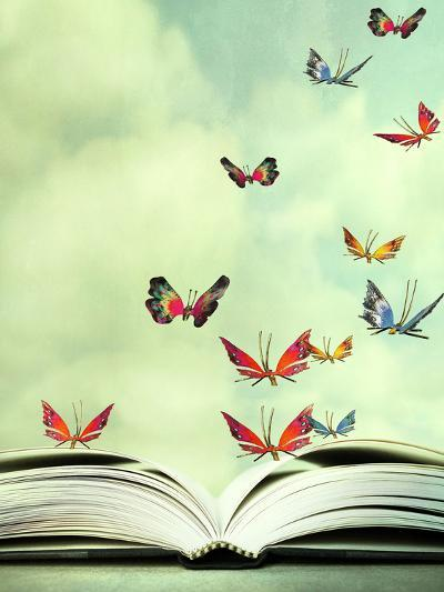 Artistic Image Of An Open Book And Colorful Butterflies That Hover
