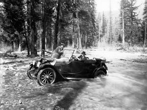 Auto Fording Clear Creek, Yakima, 1918 by Asahel Curtis