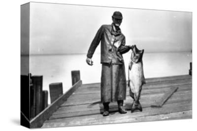 Cannery Worker with Salmon, Circa 1909