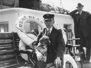 Captain Lane Erickson of the Great Bear with Dog, 1916 by Asahel Curtis