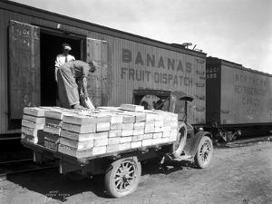 Loading Peaches in Car at Donald, 1928 by Asahel Curtis