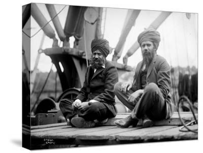Two Sikh Men Sitting on a Dock, Circa 1913