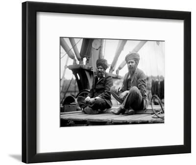 Two Sikh Men Sitting on a Dock, Circa 1913