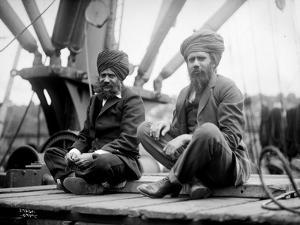 Two Sikh Men Sitting on a Dock, Circa 1913 by Asahel Curtis