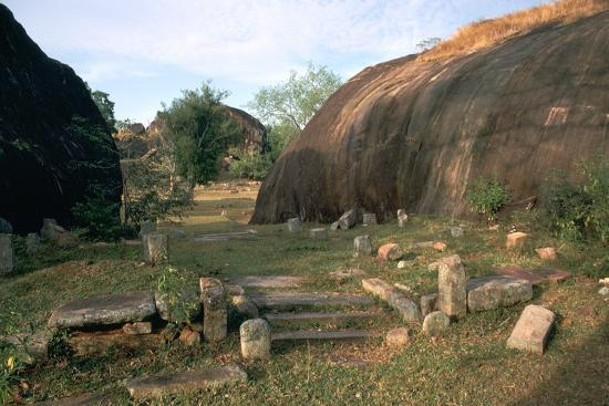 Ascetic rock-shelters for Buddhist monks in Anuradaphura, 2nd century BC. Artist: Unknown-Unknown-Photographic Print