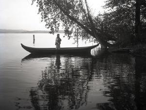 Northwest Indian Style Canoe on a Lake Washington, 1905-1906 by Ashael Curtis