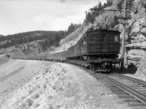 The Olympian, Electric Train in Montana Canyon, 1916 by Ashael Curtis
