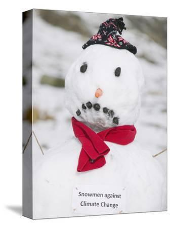 A Sad-Faced Snowman with a Sign Protesting Climate Change, United Kingdom