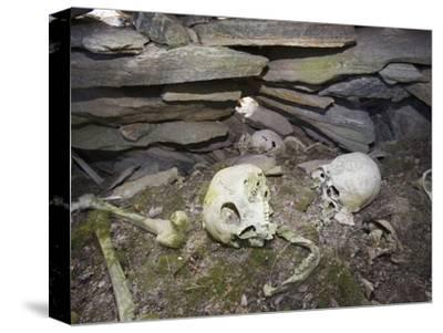 Inuit Skulls and Bones in a Stone Chambered Cairn in Ilulissat