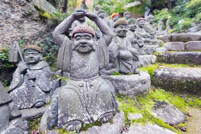 Asia, Japan, Honshu, Hiroshima Prefecture, Miyajima Island, Statues in Daisho in Temple-Christian Kober-Photographic Print