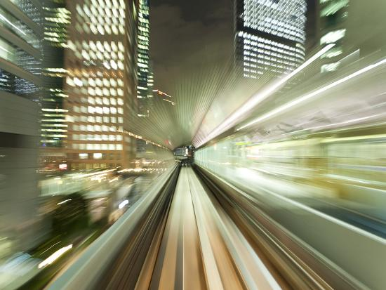 Asia, Japan, Honshu, Tokyo, Pov Blurred Motion of Tokyo Buildings from a Moving Train-Gavin Hellier-Photographic Print