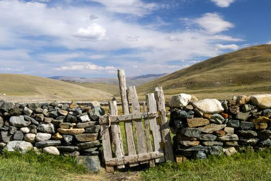 Asia, Western Mongolia, Bayan Olgii Province, Gashuun Suhayt. Stone Fence with Wooden Gate-Emily Wilson-Photographic Print