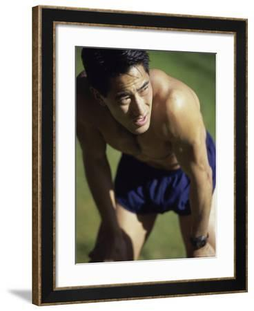 Asian Man Pausing During Workout--Framed Photographic Print