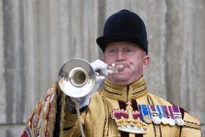 A trumpeter from the Household Cavalry by Associated Newspapers