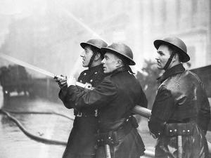 Firefighters Morning after Air Raids London by Associated Newspapers
