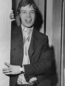 Mick Jagger in a Door by Associated Newspapers