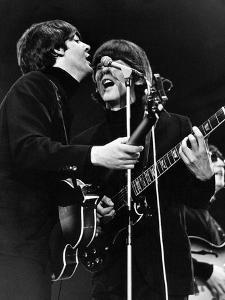 Paul Mccartney and George Harrison on Stage by Associated Newspapers