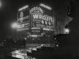 Piccadilly Circus London at Night, 1952 by Associated Newspapers