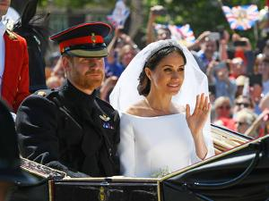 Prince Harry and Meghan Markle in the carriage after their wedding by Associated Newspapers