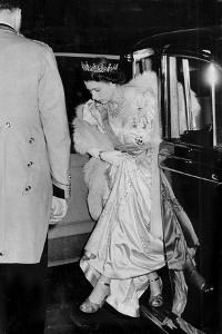 Princess Elizabeth (Queen Elizabeth II) arrives at royal event in ivory satin and furs by Associated Newspapers