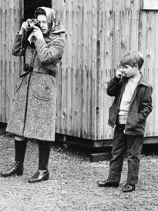 Queen Elizabeth with a young Prince Edward by Associated Newspapers