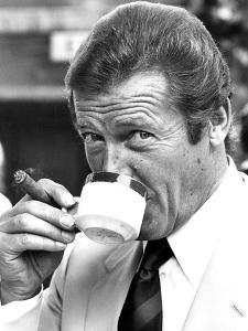 Roger Moore Drinking Coffee by Associated Newspapers