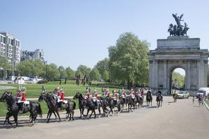 The Grenadier Guards parade on horseback at Hyde Park Corner, London by Associated Newspapers