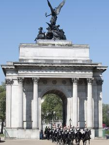 The Grenadier Guards pass through Wellington Arch at Hyde Park Corner by Associated Newspapers