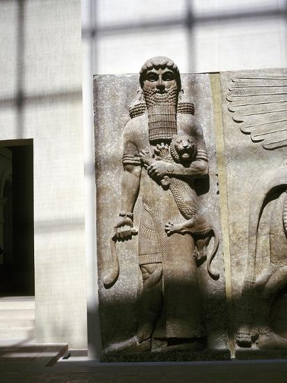 Assyrian sculpture of a man holding a lion, Khorsabad, c8th century BC. Artist: Unknown-Unknown-Giclee Print