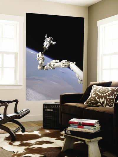 Astronaut Anchored to a Foot Restraint--Wall Mural