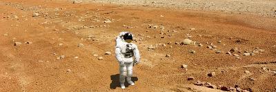 Astronaut Looking Up at an Alien Sun That Illuminates the Barren World He Stands On-Stocktrek Images-Photographic Print